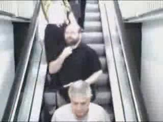Women Falling Down Escalator